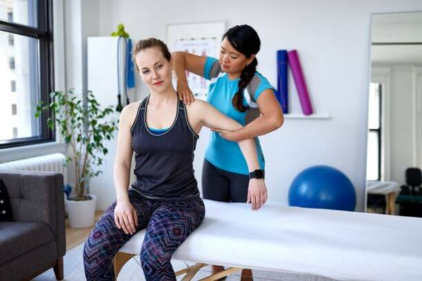 woman with a physical therapist